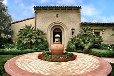 By providing a quaint bubbling fountain feature from this Terra Cotta pottery, it allowed for a focal feature for both guests who arrive and those that depart since it is centered in both the entry walkway and the front door.  Due to Terra Cotta flooring being used throughout most of the interior of the house, it was critical to link the exterior by using the same material. By using it as a banding material, steps, some veneer and the pottery, the link was established without being overwhelming.