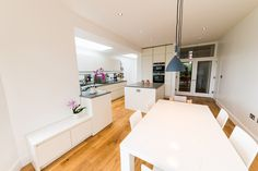 A white matt handleless German kitchen in Alexandra Park, London. The worktop is Silestone and the appliances are Siemens. One of our recent projects. Alexandra Park, German Kitchen, Table, Projects, Furniture, Home Decor, Log Projects, Blue Prints, Decoration Home