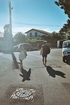 KATE & CLOVIS DONIZETTI CETUS BIARRITZ AMBASSADEUR going surfing / hot weather / shadow / surfboards / city / ready to surf in cetus yamamoto neoprene / biarritz Biarritz, Surfboards, Yamamoto, Safari, Surfing, Weather, City, Surf, Cities