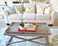 love the colors and patterns in this family room