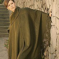 Alpaca blend poncho, 'Jade Lagoon'. Shop from #UNICEFMarket and help save the lives of children around the world.