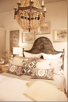 "Rustic finished bed and old chandy painted and strung with beads to look like ""restoration hardware""."
