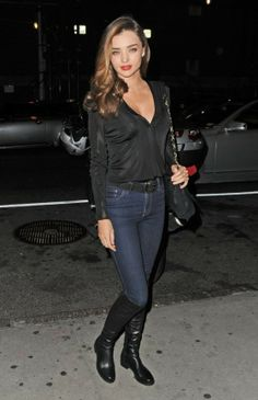 Black blouse, jeans, black boots for a casual ish night out