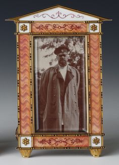 Silver, gold, guilloché enamel and ivory Fabergé frame, c. 1896, holding a photograph of Tsar Alexander III in the uniform of a Cossack General. The frame is thought to have been a gift from Tsarina Maria Feodorovna to her sister, Queen Alexandra.