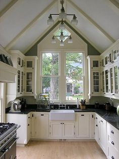 Stunning Kitchen - love the cathedral ceilings, white Shaker cupboards, Butler's sink and dark counters