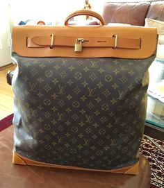 A Louis Vuitton Monogram Steamer 45 Bag that features a bold rectangular design which gives it huge carrying capacity. Originally introduced around 1900, the Steamer bag could be folded and stored in a trunk, which made it perfect for storing linens or souvenirs.