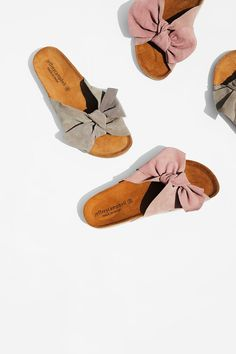 Do The Twist Sandal   Comfortable slip-on sandals featuring a femme over-the-foot bow detail with a suede design.