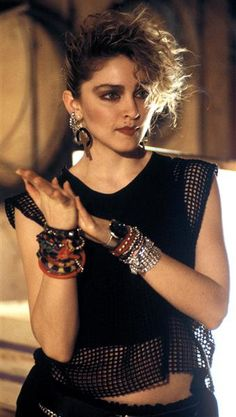In the '80s, every little girl in America wanted to be Time fashion muse, Madonna, seen here performing on a German TV show on March 1984