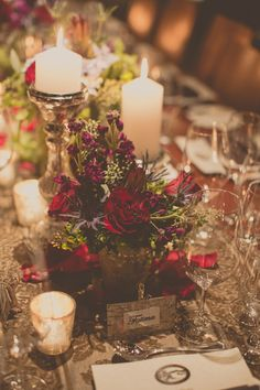 Vintage Gathering Wedding Flowers: winter wedding centerpieces // photo by Tree of Life Films // http://ruffledblog.com/lake-placid-winter-wedding