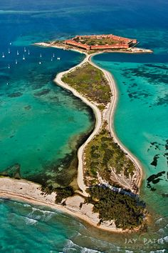Dry Tortugas National Park - Florida - It is an island and a national park with a coral reef all around the island - it is about a 3 hour boat ride from Key West