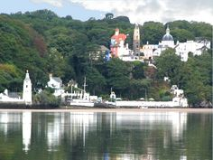Portmeirion is a popular tourist village near Minffordd, North Wales. It was designed and built by Sir Clough Williams-Ellis between 1925 and 1975 in the style of an Italian village and is now owned by a charitable trust. Italian Village, Le Village, Places To See, Places Ive Been, North Wales, Wales Uk, Snowdonia, Places Of Interest, Britain