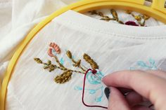 Hand Embroidery Embroidery (it's a how to on a floral top but gives good advice to use on anything you want to personalize with embroidery. - We are abosolutely in love with this embroidery DIY that Kelli made for you today! Embroidery Monogram, Shirt Embroidery, Embroidery Patterns Free, Embroidery Fashion, Crewel Embroidery, Hand Embroidery Designs, Floral Embroidery, Diy Embroidery For Beginners, Embroidered Clothes