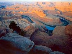 Canyonlands National Park. This landscape was eroded into canyons, buttes, and mesas by the Colorado River, Green River, and their tributaries, which divide the park into four districts. There are rock pinnacles and other naturally sculpted rock, as well as artifacts from Ancient Pueblo Peoples