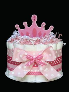 Our 1 Tier Little Princess diaper cake has 23 Pampers Swaddlers, (size 1 disposable diapers) all of which the new Mommy to be can use.     Each diaper
