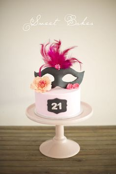 A small cake to sit on top of  a 100 cupcake stand. Masquerade 21st.  https://www.facebook.com/sweetbakess