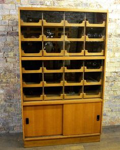 Oak Haberdashery Drapers Cabinet at D and A Binder | We have fabulous large haberdashery drawers at Binder's! It has 24 pull out drawers behind sliding glass doors as well as sliding oak doors on the base. We specialize in these rarer shirt cabinets so if you would like to see more of our display items check out DandABinder.co.uk or email us at david@dandabinder.co.uk - we'd love to hear from you!  #antique #vintage #antiques #haberdasher #antiqueshop #interiordesign #vintagestyle #homedecor…