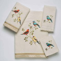 Avanti Gilded Birds 4 Piece Towel Set in Ivory.....The bird are finely detailed in blues, yellows and oranges with black, green, white and red accent colors to work with any decorating scheme.