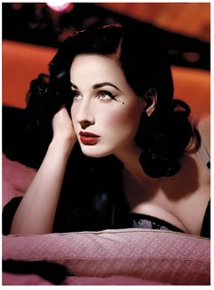 Dita Von Teese...famous for burlesque but also a great pin up model...I love this glamorous shot