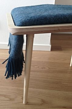 Wooden Bench that holds a folded blanket.  DesignTrade Copenhagen   Interiors Trends For Fall/Winter 2014