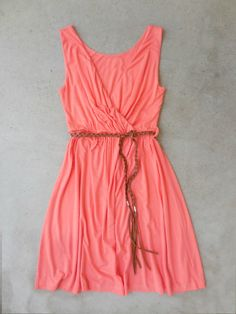 """Slip on peach dress features a surplice v-neckline, slight elastic waist and finished with a braided brown belt for a figure flattering fit. Fully lined. Cotton, Polyester. Imported. Length: 35"""""""