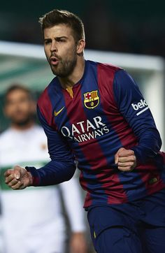 Gerard Pique of Barcelona celebrates after scoring during the La Liga match between Elche FC and FC Barcelona at Estadio Manuel Martinez Valero on January 24, 2015 in Elche, Spain.