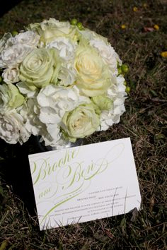 Photo of invitation and bouquet.
