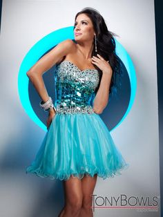 The fabric in this style is Novelty Sequin and Illusion  Strapless prom dress with sweetheart neckline, bodice of novelty sequins with beaded bust and waist accents and gathered illusion skirt.  Removable straps included. Sizes 0 – 16