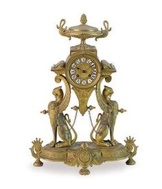 A FRENCH EGYPTIAN REVIVAL GILT-METAL AND PORCELAIN MANTEL CLOCK,  THE BASE STAMPED '4 PH MOUREY 68', CIRCA 1880