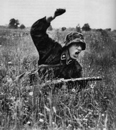 """An Untersturmführer of the 3rd SS-Panzer-Division """"Totenkopf"""" gives the signal for an attack."""