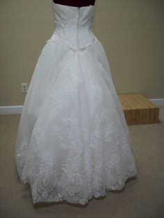 A bustle is where the train of the gown is pulled up to keep it from dragging the floor or getting stepped on and damaged during the reception. The method of bustling depends greatly on the seamstr…