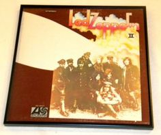 This is an actual vintage album cover containing the original vinyl record album. It has been mounted in a black plastic frame with a glass front and is ready for you to hang on your wall.   Led Zeppelin - Led Zeppelin II  Led Zeppelin has been credited with being as influential in the 1970's as the Beatles had been in the 1960's.