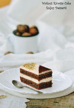 Prajiturile cu nuci si cacao sunt printre preferatele mele. Aroma de nuca face orice prajitura speciala. Nuci, cacao si ricotta puse impreuna duc la aceasta minunata prajitura cu nuca si ricotta. Este o prajitura cu blat usor dens – si foarte bun – cu nuci si un strop de cacao. Umplutura este simpla, o crema […] Romanian Desserts, Romanian Food, Homemade Chocolate, Chocolate Cake, Cake Recipes, Dessert Recipes, Ricotta Cake, Layered Desserts, Food Cakes