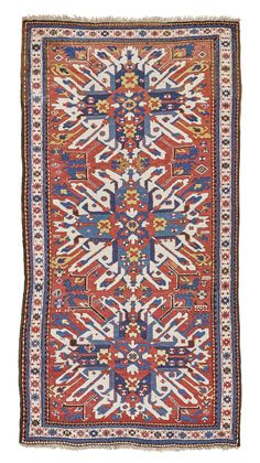 Chelaberd 'Sun-burst' Kazak Rug, Southwest Caucasus with madder field and three ivory 'sun-burst' Chelaberd stars, with ivory border with madder star rosettes on a vine scrolling trellis approximately 267 by 138cm; 8ft. 9in., 4ft. 6in. late 19th century