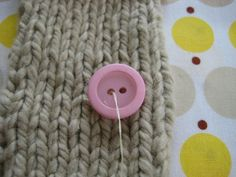 Sewing buttons onto hand knits. Need to learn how to do this properly.