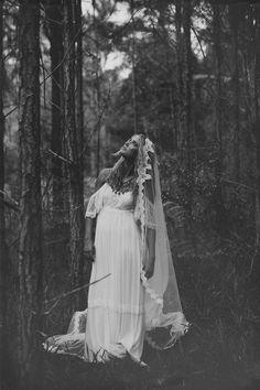 Stunning low lace back wedding dress with silk chiffon body perfect for beach or garden vintage bohemian wedding. $1,200.00, via Etsy.