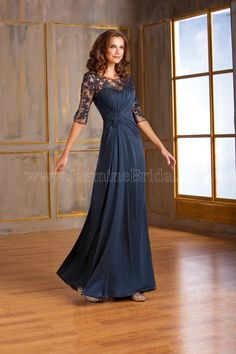 Jasmine Bridal Mother of the Bride/ Groom Dress Jade Style J175003 in Navy. A dress that will set you apart from the rest for your next special occasion. This stretch illusion dress has an elegant scoop neckline and an A-line skirt. Details on the dress includes beautiful lace detail on the bodice and ruching on the neckline.