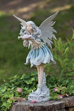 Superieur This Wishful Fairy Statue Will Bring Loveliness To Your Garden Or Home With  The Purity Throughout Her Poise. Her Soft Blue Dress And Pink Flower She  Gently ...