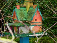 This birdhouse is a small replica of the actual house it belongs to.  Such pretty colours.