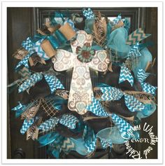 Turquoise and Burlap Wreath with Cross * Please note, we do not purchase a bunch of the same cross. Cross may vary, but will still be as stunning as the one shown in the picture. We will make every ef