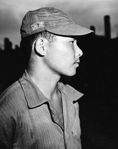 80-G-490266: Japanese Surrender, August-September 1945. At a Japanese prisoner of war camp on Guam, a prisoner is seen in clothing issued by the camp. Photograph released September 11, 1945. U.S. Navy Photograph, now in the collections of the National Archives.