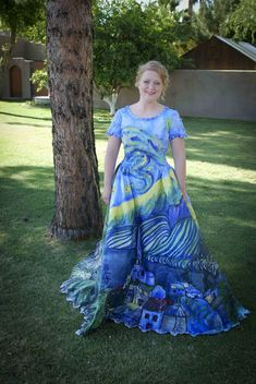 """Creativity: a wedding dress repurposed as a prom dress, hand-painted in """"Starry Nights"""" theme."""