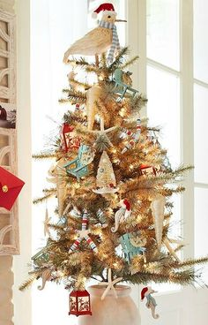 Beach Christmas Tree Decorations.... http://www.beachblissdesigns.com/2016/11/beach-christmas-tree-decorations.html Santa goes to the beach at Pier 1, blending white, red and relaxing blue.