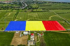 Romania has the largest flag in the world. Antena 3 Romania entered the giant flag in GUINNESS WORLD RECORDS ™ on May flag is spreading over square meters . Romanian Flag, Guinness Book, Flag Colors, Pictures Of The Week, Bucharest, National Flag, World's Biggest, World Records, Eastern Europe