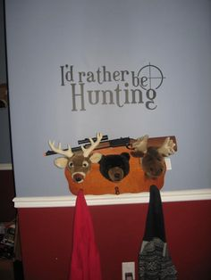 Hunting Wall Decal in my sons room.  Coat/hat rack from Cabelas.  PRETEND gun.