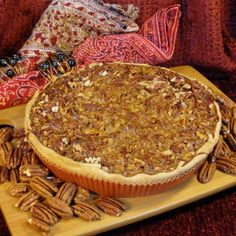 Pecan Pie w/ Maple Syrup; Like Big Ma, we make this pie with freshly shelled & toasted pecans & maple syrup so it's not too sweet. Instead, serious & satisfying.