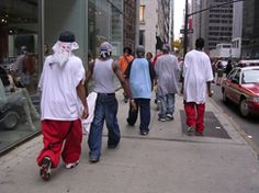 {Fig. 10} Quintessential hip hop fashion including baggy shirts and pants, baseball caps worn backwards, head wraps, bandanas, and untied. sneakers  Photo by Tatiana Sayig, 2007