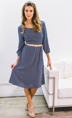 """A simple and stylish dress with fun leaf print is perfect for summer and transitioning into fall. Availble in Navy Blue and Red!  """"Teryn"""" Modest A-line Dress in Navy Blue with White Leaf Print"""