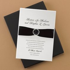 Dressed to the Nines - Invitation  Oozing with glamour and elegance, this invitation features a printed latte shimmer top layer and ecru vellum base card. A black satin ribbon and rhinestone buckle hold them together.