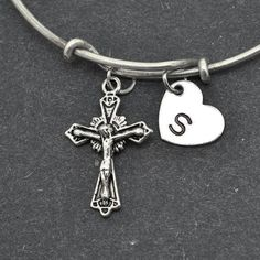 A personal favorite from my Etsy shop https://www.etsy.com/ca/listing/248665880/cross-bangle-sterling-silver-bangle