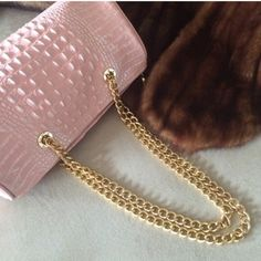HP 2/12/16 THE FIND- HANDBAG This Bag is Spectacular and Chic!    Pink Crocodile embossed with beautiful Gold Chains.  One Zippered Pocket and two open pockets inside.      7 1/2 inches tall.   12 inches in width.    This Bag is in LIKE NEW CONDITION!   Comes with Dust Bag!                   HP 2/12/16 Pretty Flirty & Girly Party  The Find Bags Shoulder Bags
